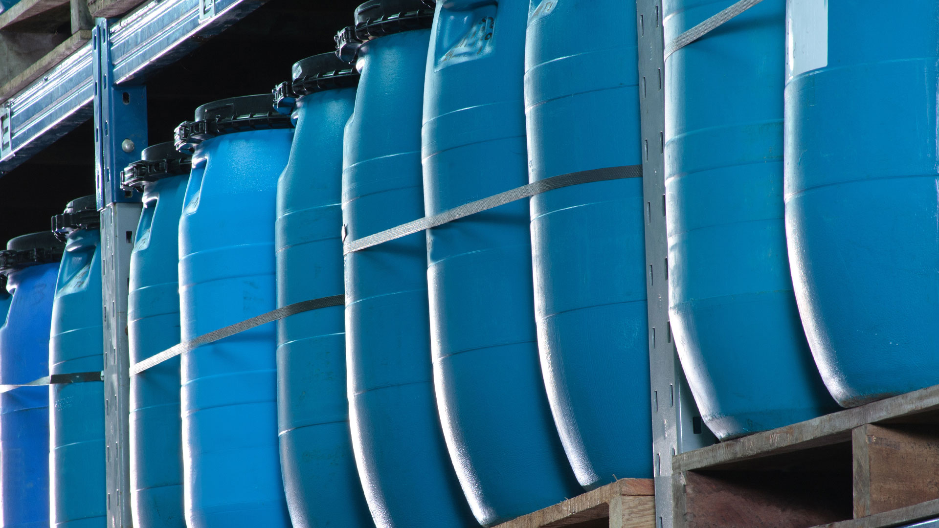 blue plastic storage drums